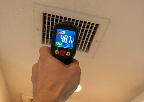 temperature gauge pointed at ac ducting